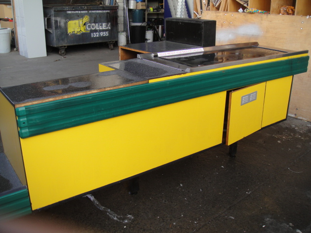 Yellow Check Out Counter with Conveyor